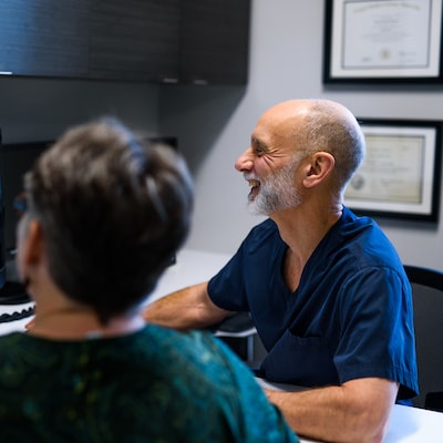 Dr. Pasquinelli explaining how periodontal maintenance can help prevent oral cancers