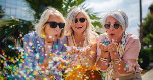 Three mature women enjoying their dental implants outside
